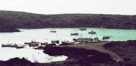 Old Small Fishing Bay with Traditional Boats of Menorca, Balearic Islands. Retro styled Foto de archivo