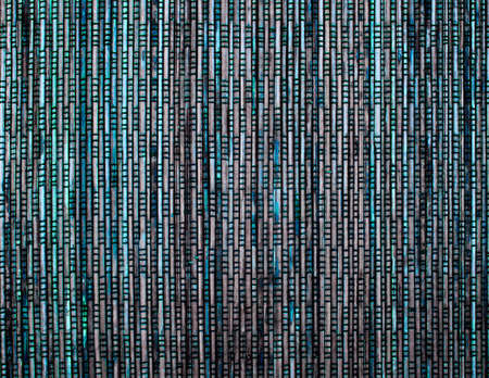 Background of Brown, Blue and Green Wicker Straw Mat closeup Foto de archivo