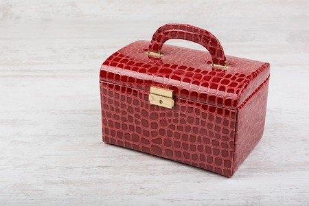 jewelery: Red leather jewelery box on white wooden background