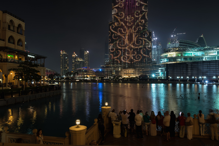 DUBAI, UNITED ARAB EMIRATES - DECEMBER 7, 2016: View to Burj Khalifa tower, the tallest man-made structure in the world at night, 828 m. LED lighting show. Editorial