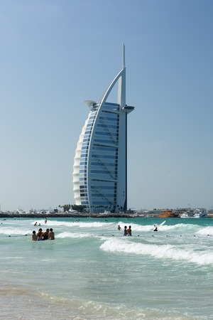 DUBAI, UNITED ARAB EMIRATES - DECEMBER 9, 2016: Cityscape of Burj Al Arab Hotel from Jumeirah beach. It is a luxury hotel located in Dubai, United Arab Emirates, the fourth tallest hotel in the world. Editorial