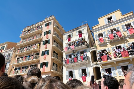 smashing: CORFU, GREECE - APRIL 30, 2016: Corfians throw clay pots from windows and balconies on Holy Saturday to celebrate the Resurrection of Christ. Easter pot smashing.