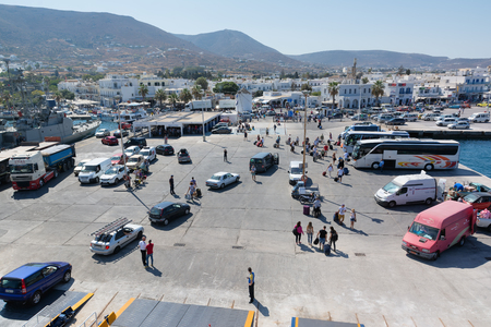 disembark: PAROS, GREECE, SEPTEMBER 17, 2016: Passengers and cars disembark from the ship at the port of Paros in Greece. Paros is a beautiful Cycladic island visited by too many tourists every year.