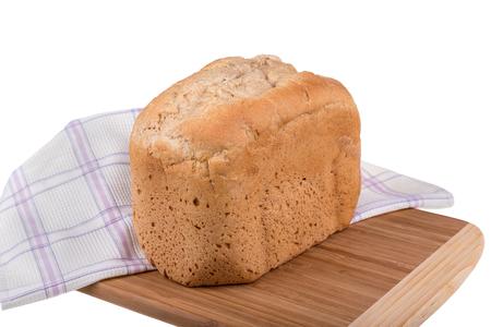 Homemade wholemeal spelt and white flour bread isolated on white background, baked in bread maker. Stock Photo