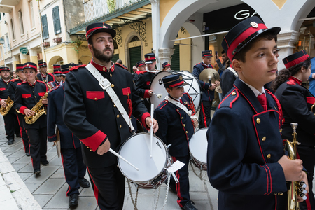 CORFU, GREECE - APRIL 29, 2016: Philharmonic musicians playing in Corfu Easter holiday celebrations. Corfu has a great tradition in music, with 18 philharmonic bands playing a major role on the island's music education and culture. Archivio Fotografico - 96882432