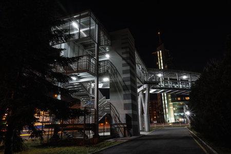 BURGAS, BULGARIA - FEBRUARY 1, 2018: Overhead pedestrian bridge at night near Mirage Hotel. Editorial