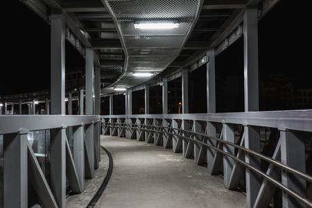 Overhead pedestrian bridge at night in Burgas, Bulgaria. Stock Photo