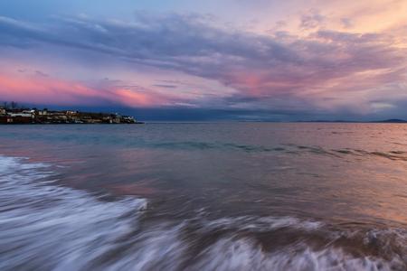 Colorful sunset at the fishing village near Ravda, Bulgaria. Sea sunset at Black Sea coast.