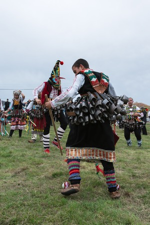 MEDOVO, BULGARIA - MARCH 17, 2018: People in traditional carnival masquerade costumes at Kukeri Festival, Medovo village near Burgas, Bulgaria.