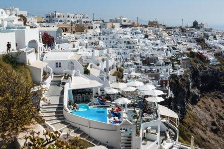 Santorini, Greece - September 18, 2016: View of Imerovigli village with typical white Greek houses on Santorini island, Greece.