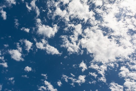 Clear sunny blue sky with white clouds background
