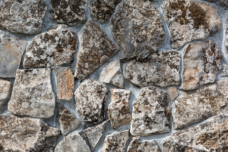 Background texture of stone wall. Stone wall with moss and lichen Stock Photo