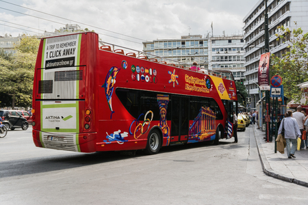 ATHENS, GREECE- SEPTEMBER 23, 2016: Red tourist sightseeing double decker bus in Athens, Greece. Athens is the capital and largest city of Greece.