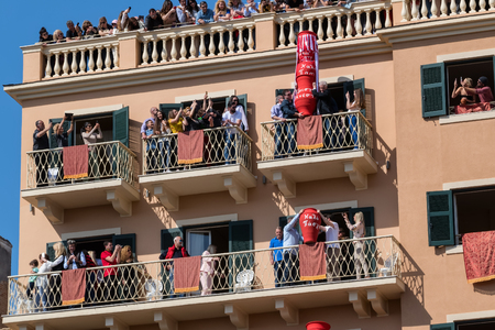 CORFU, GREECE - APRIL 7, 2018: Corfians throw clay pots from windows and balconies on Holy Saturday to celebrate the Resurrection of Christ. Easter pot smashing. Editorial