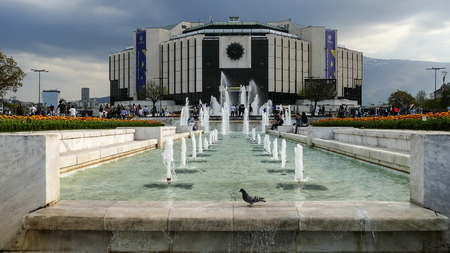SOFIA, BULGARIA - APRIL 14, 2018: Fountains in front of the National Palace of Culture, Sofia, Bulgaria.