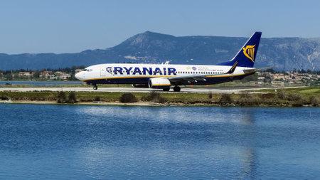 CORFU, GREECE - APRIL 8, 2018: Modern passenger airplane of Ryanair airlines on runway before take off in airport of Corfu island, Greece.