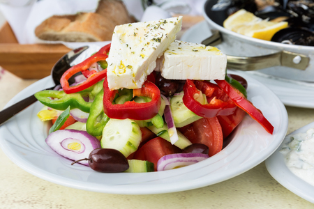 Traditional greek salad with fresh vegetables, feta cheese and olives.