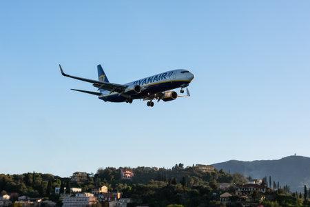 CORFU, GREECE - APRIL 3, 2018: Modern passenger airplane of Ryanair airlines before landing in airport of Corfu island, Greece. Editorial