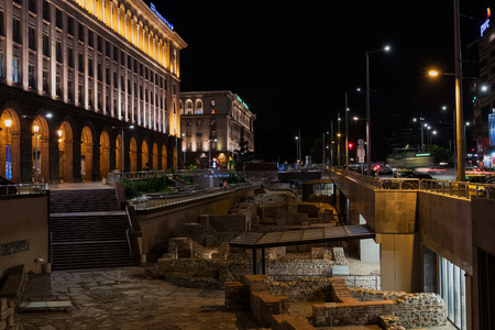 SOFIA, BULGARIA - APRIL 27, 2018: Night view of the City centre of Sofia. Old ruins of Ancient Serdika.