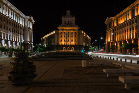 The City centre of Sofia at night, Bulgaria. Buildings of Presidency, Council of Ministers and Former Communist Party House. Text National Assembly in Bulgarian on the building. Editorial