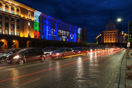 SOFIA, BULGARIA - MAY 8, 2018: Building of Council of Ministers in Sofia, Bulgaria. 3D Projection Mapping for the Day of Europe. Night view with traffic light trails.
