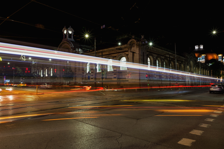 SOFIA, BULGARIA - MAY 8, 2018: Tsentralni Hali, Central Hali Market Hall, Halite, is a commercial complex in downtown of Sofia, Bulgaria. Night view with traffic light trails.