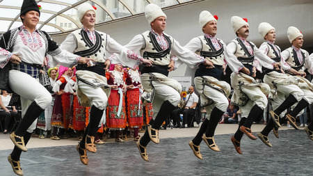 SOFIA, BULGARIA - MAY 7, 2018: People in traditional costumes dance bulgarian horo in Sofia, Bulgaria.