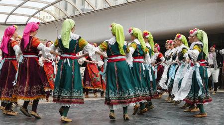 SOFIA, BULGARIA - MAY 7, 2018: People in traditional costumes dance bulgarian horo in Sofia, Bulgaria.