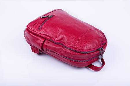 Red leather fashionable female backpack on white background. Stock Photo