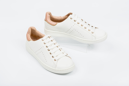 Womens sport leather shoes on white background. Stock Photo