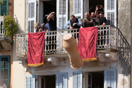 CORFU, GREECE - APRIL 7, 2018: Corfians throw clay pots from windows and balconies on Holy Saturday to celebrate the Resurrection of Christ. Easter pot smashing. 에디토리얼