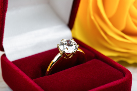 Diamond wedding ring in a red gift box.