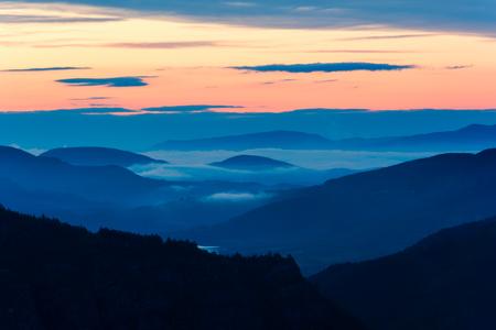 Foggy sunrise over Rodopi mountain, Bulgaria. Mountain landscape