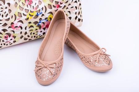 Pair of fashionable female shoes on white background Stock Photo