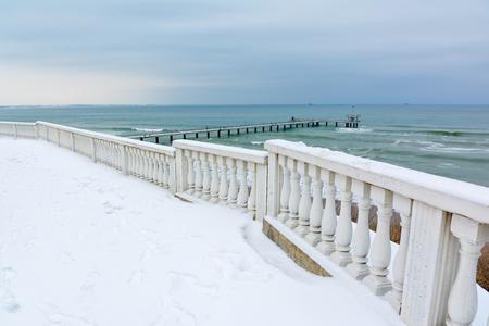 Snow Black Sea landscape in Burgas bay, Bulgaria. Burgas bridge in winter.