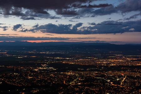 View to the Sofia city at dusk. View from the Kopitoto Hill, Vitosha Mountain, Bulgaria