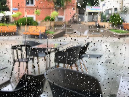 Urban view of rain drops falls on a window during a stormy day in Burgas, Bulgaria