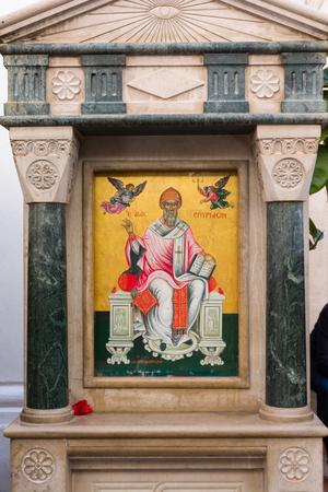 CORFU, GREECE - APRIL 7, 2018: Icon of the patron saint of Corfu Town, Saint Spyridon in front of the Saint Spyridon Church, Kerkyra, Greece.