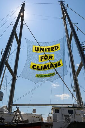 BURGAS, BULGARIA - JUNE 7, 2019: Text United For Climate on the board of Greenpeace Rainbow Warrior sailing ship at the Port of Burgas, Bulgaria.