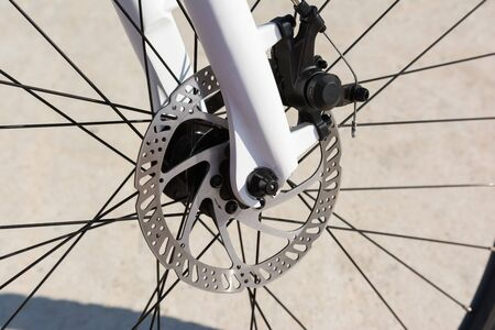 Closeup of a bicycle front disc brake. High quality hydraulic braking system available in the bicycle industry Banco de Imagens