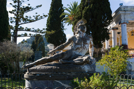 CORFU, GREECE - MARCH 4, 2017: Sculpture of the Dying Achilles in the garden of Achilleion palace in Corfu Island, Greece, built by Empress of Austria Elisabeth of Bavaria, also known as Sisi.