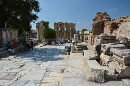 EPHESUS, TURKEY - AUGUST 16, 2017: Celsus Library in Ephesus ancient city, Selcuk, Turkey. Curetes Street.