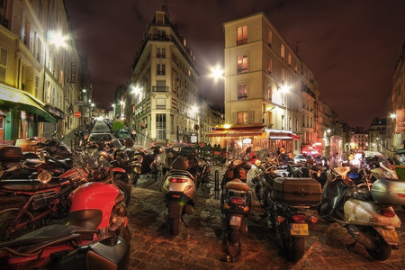 France, Paris - Spring 2008: Motorcycles parked on the crossroads rue Maurice Utrillo, rue Paul Albert, rue Feutrier and rue Muller. Paris. France Editorial