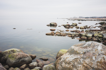 Stony coast of the Baltic Sea. Foggy spring morning. Leppneeme sadam. Estonia