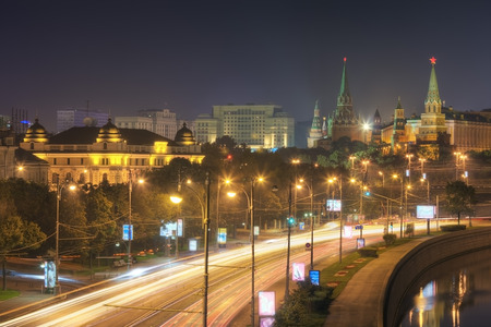 View of the Kremlin, Moskva River and Prechistenskaya embankment at night in summer. Moscow. Russia
