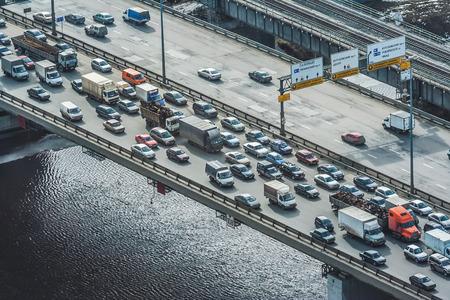 Dense traffic on the bridge over the river