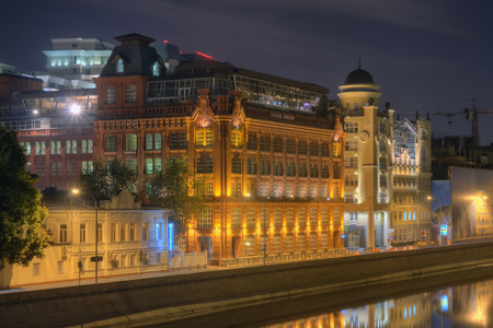 View from the Patriarchal bridge on the Yakimanskaya embankment and the Vodootvodny Canal at night. Moscow. Russia
