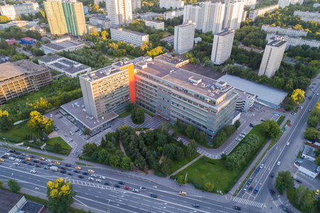 View of a modern building at the crossroads from the height. Summer time. Aerial photo from a drone from a altitude Stock Photo