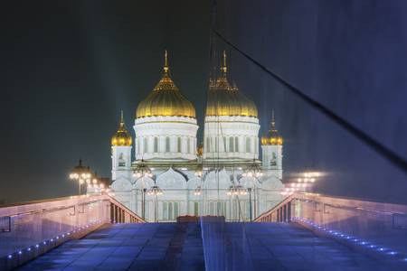 Reflection of the Patriarshy Bridge and Cathedral of Christ the Saviour (Khram Khrista Spasitelya) at night. Moscow. Russia