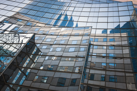 Reflection of office buildings on the glass of one of the buildings in the business center of La Defense. Paris. France Stok Fotoğraf